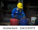 A Worker Industry Wearing...