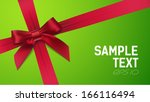 red bow on green background | Shutterstock .eps vector #166116494