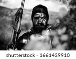 Poacher with Rifle Spotting Some Deers. Illegal Hunting Poacher in the Forest. Hunting season. Poacher concept - stock photo