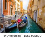 Narrow Canal With Gondola And...