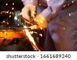 Man Processing Metal In Factory