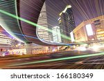 the light trails on the modern ... | Shutterstock . vector #166180349