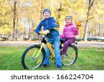 children on a bicycle in autumn ... | Shutterstock . vector #166224704
