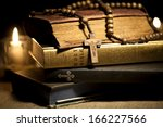 old holy bibles  rosary beads... | Shutterstock . vector #166227566
