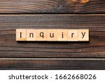 Small photo of inquiry word written on wood block. inquiry text on table, concept.