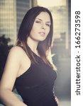 brunette beauty in city downtown | Shutterstock . vector #166273598