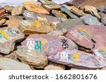 Small photo of Mani Stones with mantra written in Sanskrit 'Om Mani Padme Hum' meaning compassion,ethics,patience, diligence, renunciation & wisdom in English at Kunzum Pass, Lahaul Spiti Himachal Pradesh.