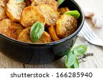 round spicy baked potatoes with ... | Shutterstock . vector #166285940