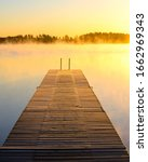 Wooden Jetty On A Misty Lake At ...