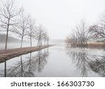 misty lake in morning | Shutterstock . vector #166303730
