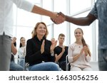 Small photo of business training participants applaud at the seminar