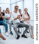 Small photo of group of young people applaud at a group meeting
