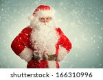 santa claus standing in a snow... | Shutterstock . vector #166310996