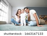 Cute Baby With Parents At Home