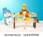 Wooden Mannequin On A Snowy...