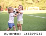 Two Little Toddlers Arguing At...