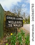 Small photo of Bilingual Welcome to Wales sign in Welsh and English marking the border between England and Wales on the old coaching route at the town of Chirk UK