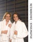 Small photo of Women wearing bath robe at spa, portrait