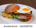cheeseburger with eggs | Shutterstock . vector #166368920
