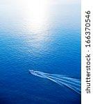 Boat Cruising Blue...