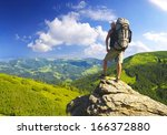 tourist on the rock. sport and... | Shutterstock . vector #166372880