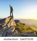 winner on the mountain top.... | Shutterstock . vector #166373150