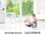 Cute Toddler Girl Playing With...