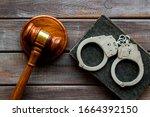 Arrest Concept. Handcuffs Near...