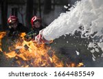 Firefighters Extinguish A Fire. ...