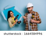 Small photo of emotional workman with hammer and woman with electric drill in torn paper, isolated on blue