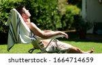 Man Sunbathing Outside In Home ...