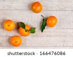 five tangerines with leaves on... | Shutterstock . vector #166476086
