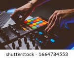 Small photo of Dj plays beats on drum machine.Hip hop disc jockey playing on concert stage with professional midi controller device. Beat machine device for electronic music composer. vintage photo processing