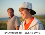 smiling teen with father | Shutterstock . vector #166481948