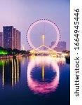 Small photo of Night scene cityscape of Tianjin ferris wheel,Tianjin eyes in twilight time.Most Modern and popular landmark in Tianjin city.