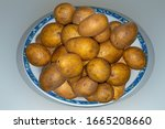 Various Unpeeled Potatoes On A...
