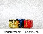 gift boxes on glitter silver... | Shutterstock . vector #166546028