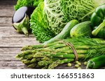fresh green vegetables on... | Shutterstock . vector #166551863