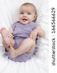 cute active baby smiling   Shutterstock . vector #166566629