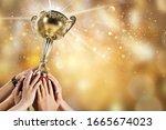 Human Hands Raise Golden Trophy ...