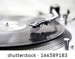 record player with a vinyl for... | Shutterstock . vector #166589183