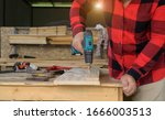 The Carpenter Works With Wood...