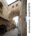 Small photo of Jerusalem/Israel - December 30 2019: Central Ecce homo arch on Via Dolorosa, now partially hidden by subsequent construction, believed to be the place of Jesus' trial.