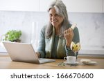 senior woman working at pc... | Shutterstock . vector #166670600