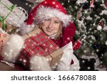 happy girl with presents near... | Shutterstock . vector #166678088