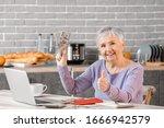 Senior Woman Counting Money At...