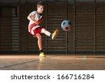 little boy shooting at goal | Shutterstock . vector #166716284