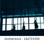 silhouettes of business people... | Shutterstock . vector #166721450
