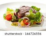 rib eye steak with  vegetables   Shutterstock . vector #166726556
