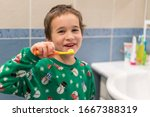 Close up of young boy brushing...